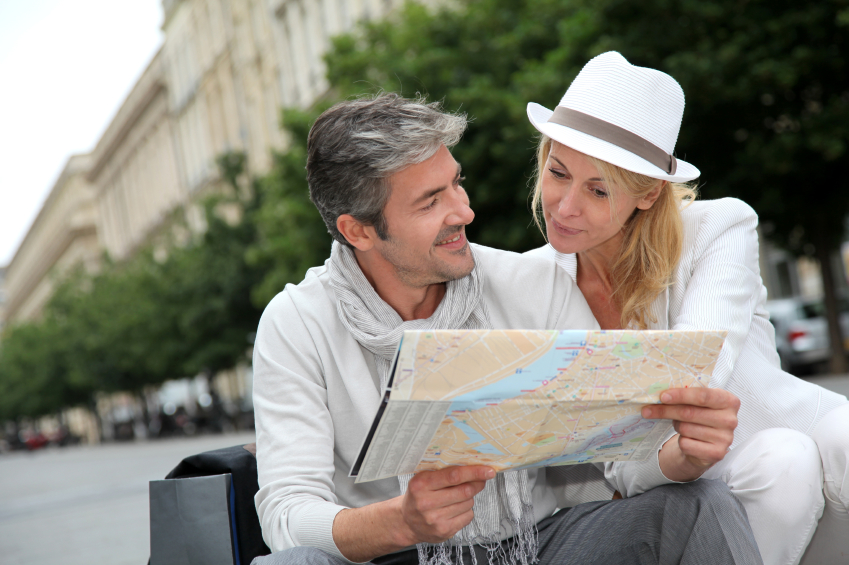 Mature couple examining a map while traveling on vacation