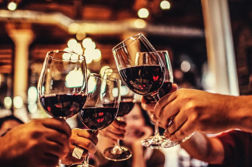wine bar interior, clinking wine glasses