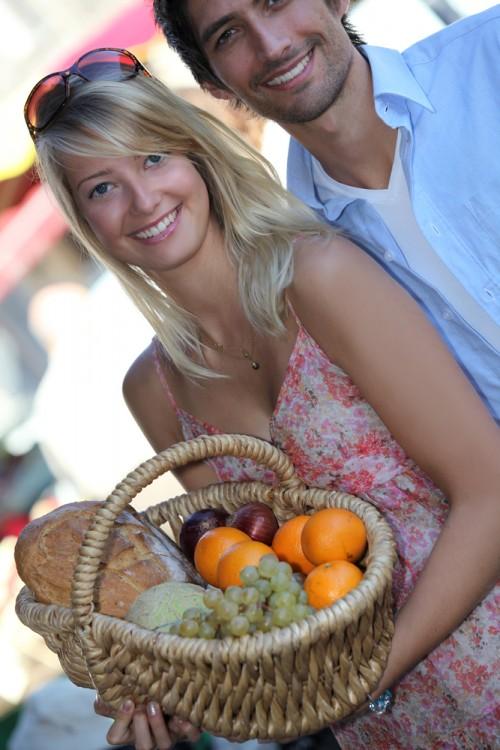 Couple buying fruits