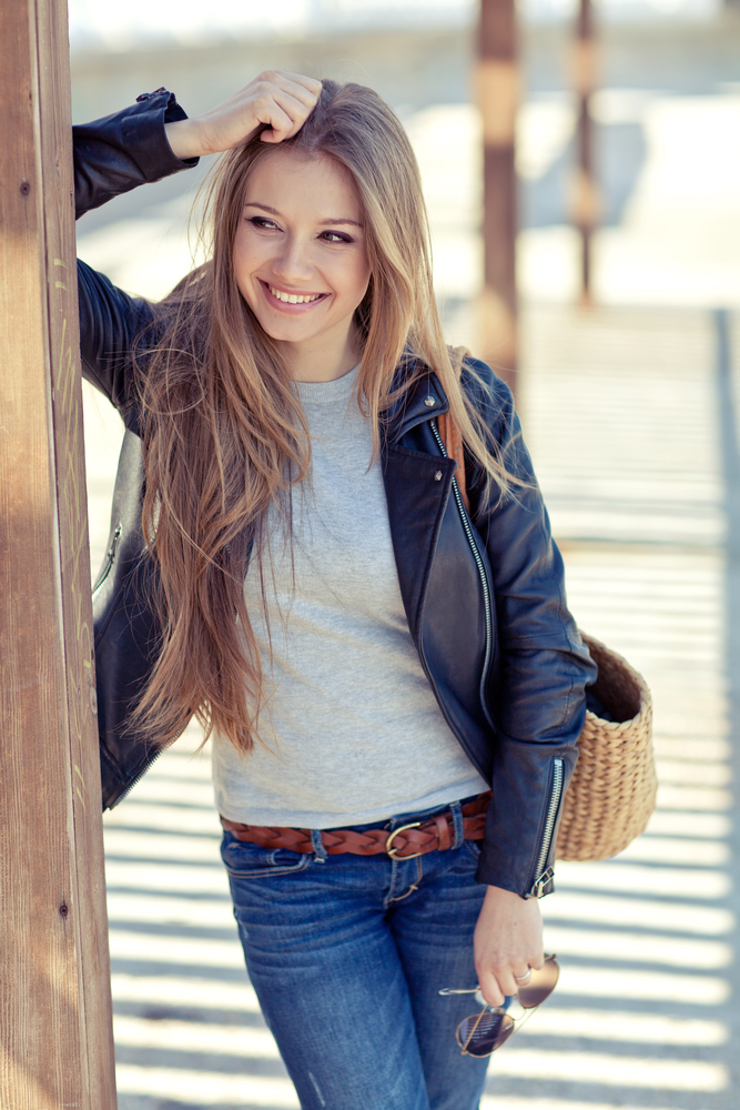 Woman wearing leather jacket