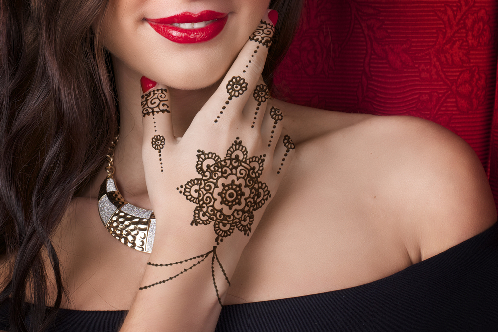Woman with henna art on her hands