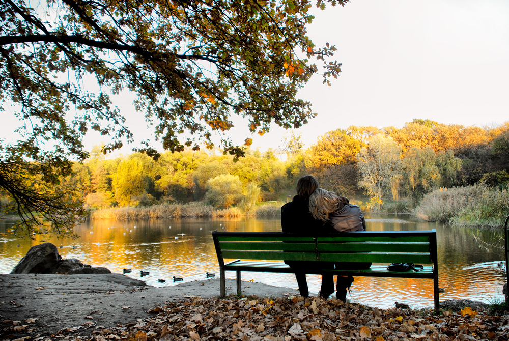 Couple sitting by a lake