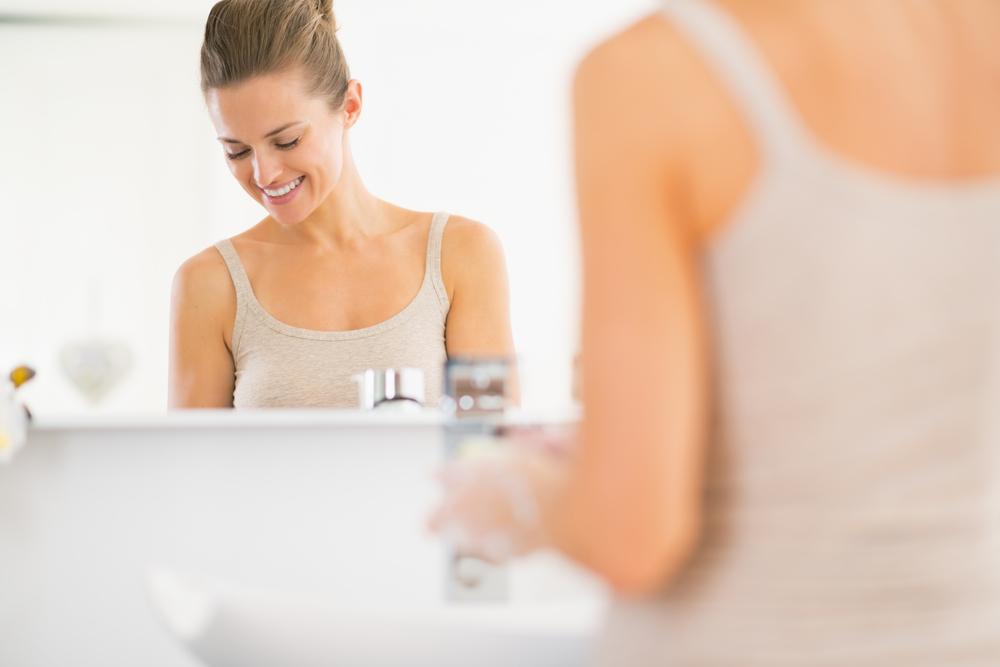 Women washing her hands.