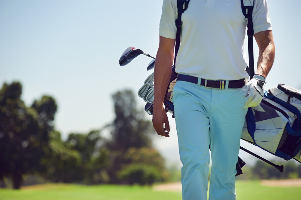 Man with golfing equipment