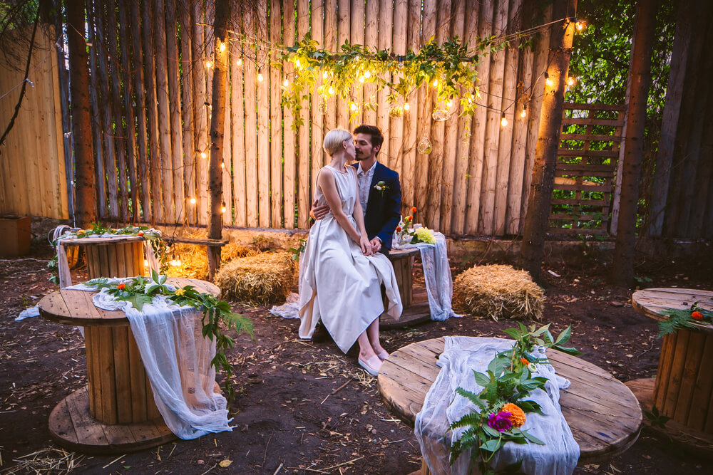 newlyweds in rustic setting