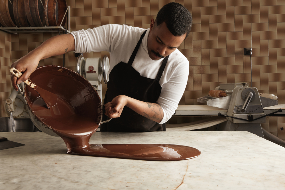 man pouring chocolate